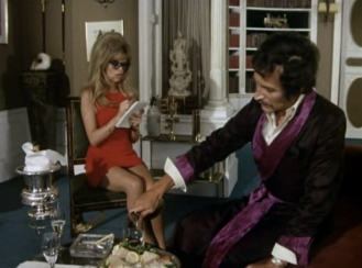 Peter Wyngarde as Jason King and Edina Ronay as Miss Simms