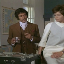 Peter Wyngarde as Jason King and Annabelle Hurst played by Rosemary Nichols