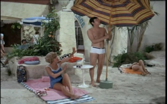 Joel Fabiani as Stewart Sullivan basking in the sun