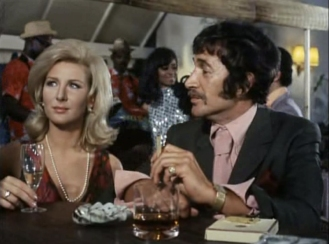 Peter Wyngarde as Jason King and Caron Gardner as Billie