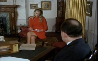 David Bauer as Harlan with his secretary