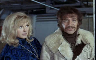Peter Wyngarde as Jason King and Wanda Ventham as Leila
