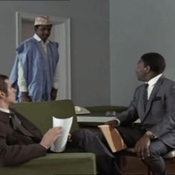 Joel Fabiani as Stewart Sullivan and Dennis Alaba Peters as Sir Curtis Seretse