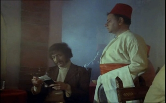 Peter Wyngarde as Jason King and Victor Baring as the waiter