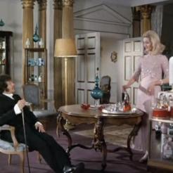 Jason King being entertained by Caroline Blakiston as Kate Mortimer