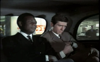 Joel Fabiani as Stewart Sullivan and Dennis Alaba Peters as Sir Curtis Seretse