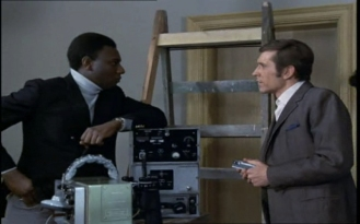 Dennis Alaba Peters as Sir Curtis Seretse and Joel Fabiani as Stewart Sullivan