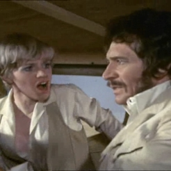 Peter Wyngarde as Jason King and Hilary Pritchard as Lydia
