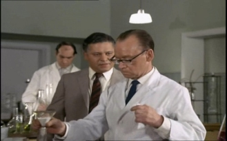Wolfe Morris as Takla and John Cazabon as Chemist