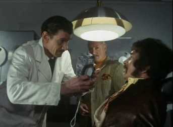 Michael Gwynn as Drieker and Peter Wyngarde as Jason King
