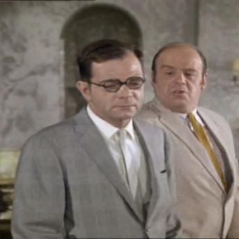 Peter Arne as Slovic and John Savident as Captain Svenoski