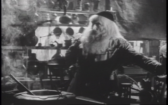 Cyril Smith as Merlin