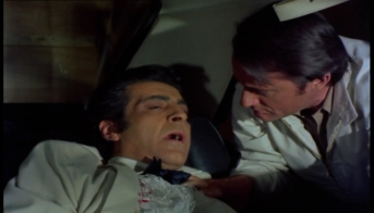 Paul Stassino as Captain Carozza and Robert Vaughn as Harry Rule
