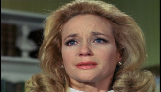 Sylvia Syms as Carol Webber