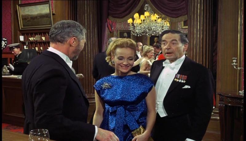 Sylvia Syms as Carol Webber and Leo Genn as George Halliday