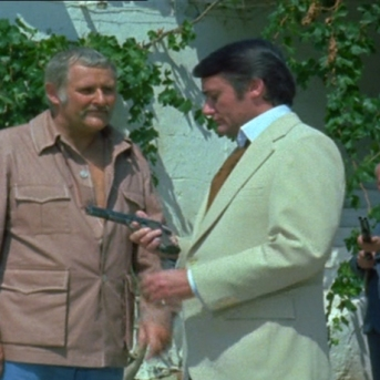 Peter Vaughan as Quin and Robert Vaughn as Harry Rule